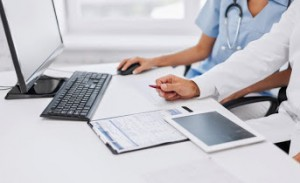 group-of-doctors-looking-at-tablet