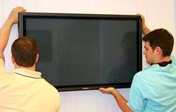 men-installing-monitor