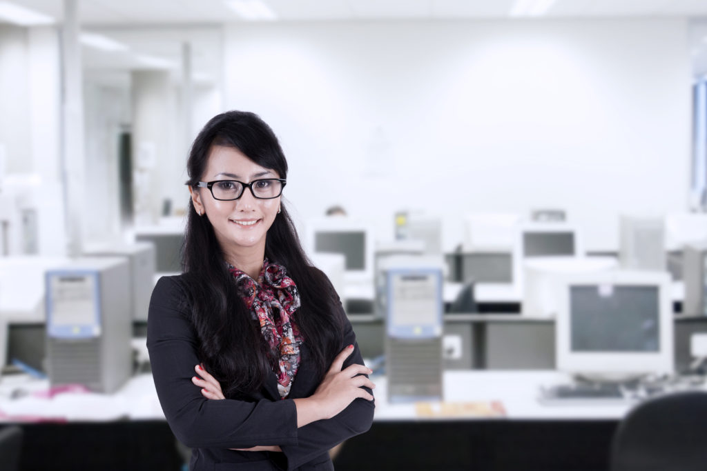 Confident Businesswoman with glasses isolated over white